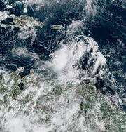In this satellite image taken Monday, Sept. 23, 2019, Tropical Storm Karen is seen swirling in the Caribbean Sea south of Puerto Rico.