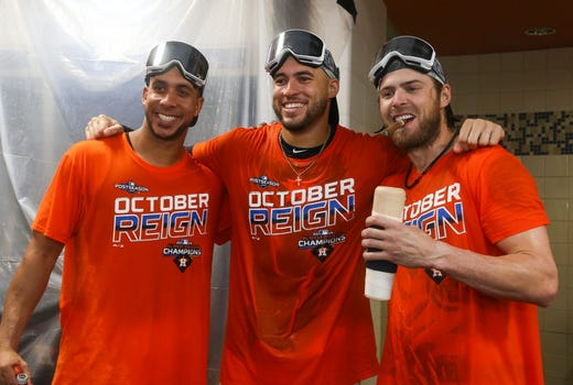 Houston Astro outfielders Michael Brantley, George Springer and Josh Reddick celebrate after winning the AL West title.