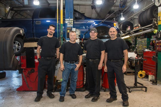 (Left to right) Mechanics John Maze, Jared Earhart, James Taylor and Ralph Longo of Earhart Automotive in Freehold. Sept. 24, 2019.