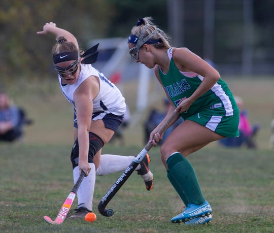 Freeold Township Chloe Rattiner tries to block forward progress of Colts Neck Bella Rivera during first half action.  Colts Neck Girls Field Hockey vs Freehold Township in Freehold Township on September 24, 2019.