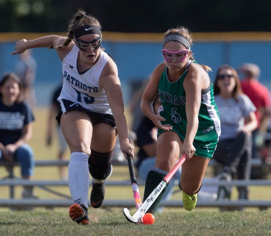 Freehold Township Chloe Rattiner and Colts Neck Ava Matino ball for ball during first half action. Colts Neck Girls Field Hockey vs Freehold Township in Freehold Township on September 24, 2019.
