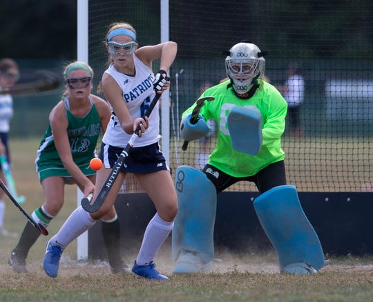 Freehold Township Catherine Papa tries to knock ball away from her goal during first half action. Colts Neck Girls Field Hockey vs Freehold Township in Freehold Township on September 24, 2019.