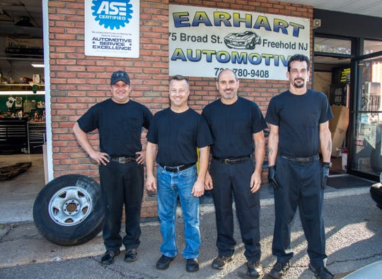 (Left to right) Mechanics James Taylor, Jared Earhart, Ralph Longo and John Maze of Earhart Automotive in Freehold. Sept. 24, 2019.