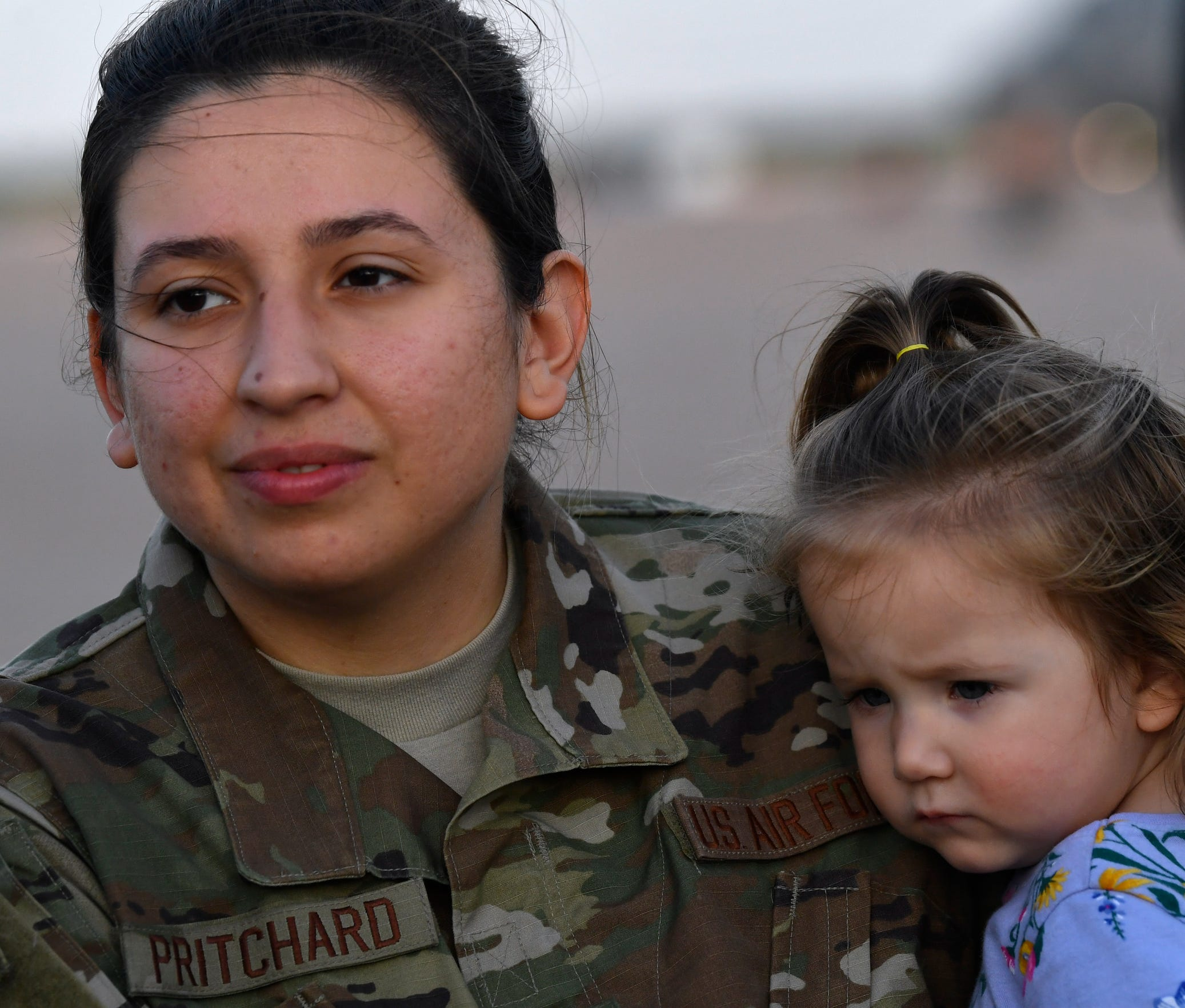 Senior Airman Jessica Pritchard holds her daughter Izabella during an interview before deploying from Dyess Air Force Base with the 39th Airlift Squadron Sept. 9, 2019. Pritchard will be in Afghanistan and away from her family for the rest of the year.