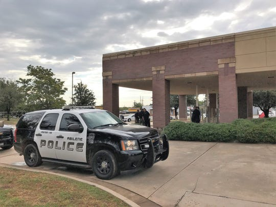 A man ambushed an employee at First State Bank Tuesday as she was coming into the building. He took an undisclosed amount of money and fled.