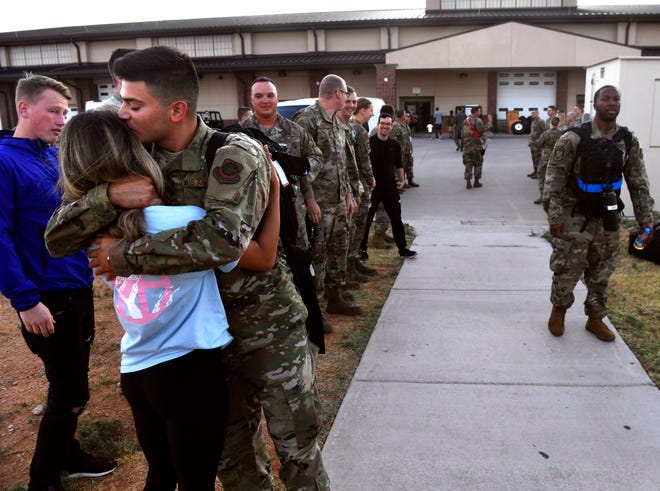 Airman 1st Class Luis Guerra-Ruiz kisses his girlfriend Kendra Fisher goodbye as the 39th Airlift Squadron deploys from Dyess Air Force Base Sept. 9. Friends and families came to wish their loved ones and the squadron a safe journey. The 39th will be deployed to Afghanistan and Africa for the remainder of the year.