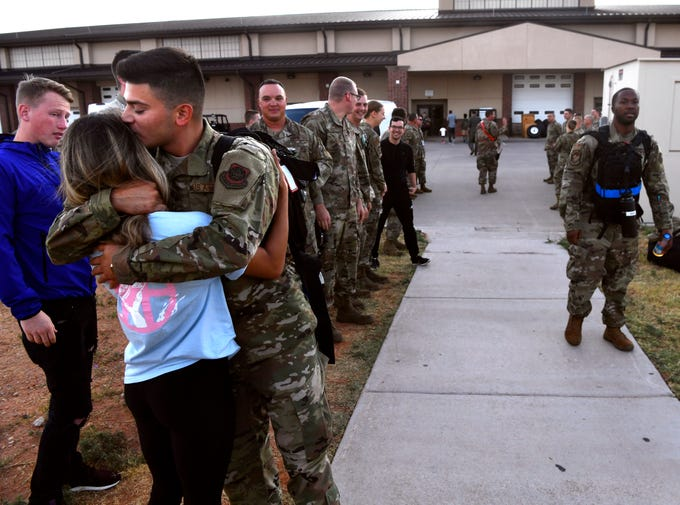 Airman 1st Class Luis Guerra-Ruiz kisses his girlfriend Kendra Fisher goodbye as the 39th Airlift Squadron deploys from Dyess Air Force Base Sept. 9, 2019. Friends and families came to wish their loved ones and the squadron a safe journey. The 39th will be deployed to Afghanistan and Africa for the remainder of the year.