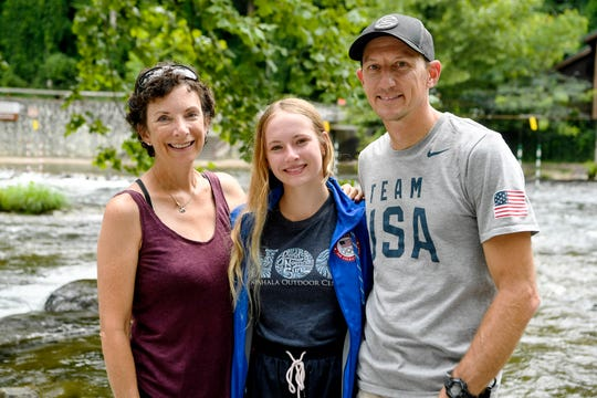 Evy Leibfarth with her mother, Jean Folger, a former whitewater paddling instructor, and father, Lee Leibfarth, a former U.S. Slalom Kayak National Team member, at the Nantahala Outdoor Center August 10, 2019.
