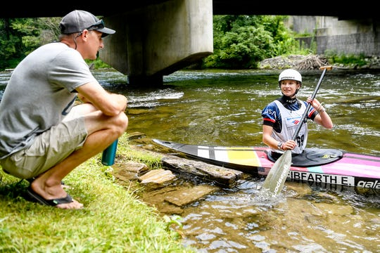 Evy Leibfarth talks to her father and coach, Lee Leibfarth, a former U.S. Slalom Kayak National Team member, at the Nantahala Outdoor Center August 10, 2019.