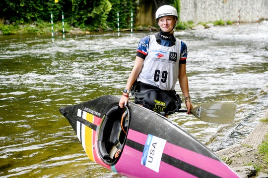 Evy Leibfarth carries her equipment out of the Nantahala River after competing August 10, 2019.