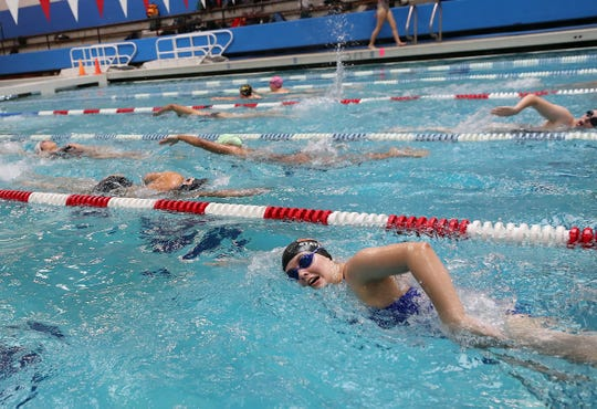 Central Kitsap's Amanda Ashmore warms up with the rest of the girls swim team during practice at the Olympic Aquatic Center on Monday, September 23, 2019