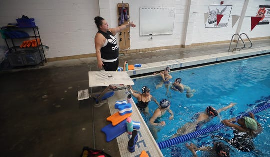 Central Kitsap swim coach Whitney Dodd gives her team instructions during practice at the Olympic Aquatic Center on Monday, September 23, 2019