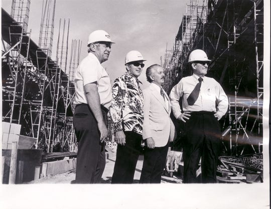 In a photo from 1973, then-TODAY Publisher Jim Jesse, from left, Al Neuharth, Ad Director Joe Lyons, and Gannett Chairman Paul Miller inspect progress on the TODAY building in Cocoa, where new off-set presses were being constructed.