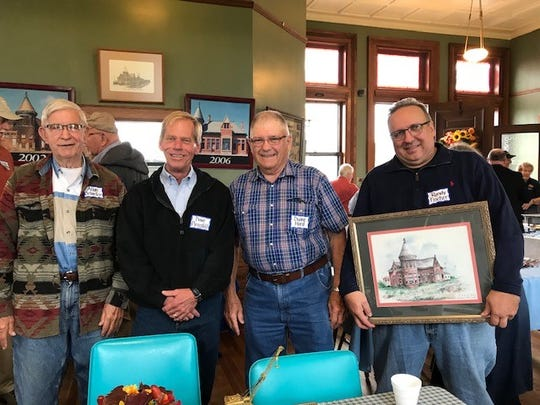 Allan Schiefer, Dave Pirnstill, Duane Hord and Randy Fischer seem happy at the close of the first-ever men's breakfast and auction Sept. 7 at the Toledo and Ohio Central train depot.