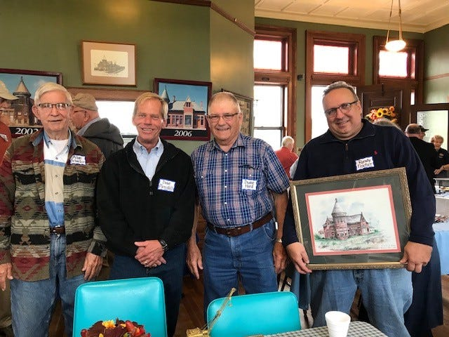 Allan Schiefer, Dave Pirnstill, Duane Hord and Randy Fischer seem happy at the close of the first-ever men's breakfast and auction Sept. 7at the Toledo and Ohio Central train depot.