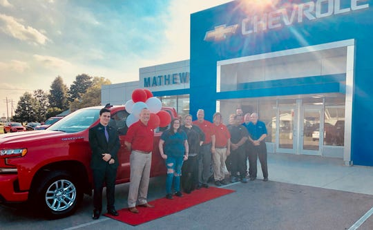 Savanna Kiser-Davidson, third from left, picks up her new Chevrolet Silverado at Mathews Chevrolet-Buick Bucyrus on Friday. The Galion woman won a two-year lease on the vehicle as part of a Central Ohio Chevy Dealers contest this summer.