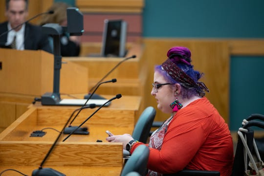Mimosa Thomas speaks out against a preposed ordinance that would prohibit activities like prohibit lying down and prohibit lying down among other things in Blucher park during public comment at a City Council meeting on Tuesday, Sept. 24, 2019.