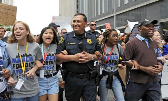 Houston Police Chief Art Acevedo marches with students from Santa Fe High School in the days following the the deadly mass shooting on May 18, 2018.