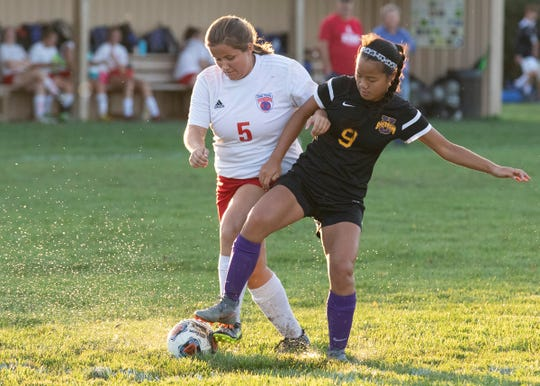 Unioto's XiXi McKell fights for the ball during a 6-1 win over Zane Trace at Unioto High School on Sept. 23, 2019, in Chillicothe, Ohio.