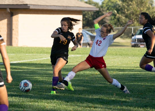 Unioto's Abi Seals and Zane Trace's Haynna Addy go after the ball during a 6-1 Unioto win at Unioto High School on Sept. 23, 2019, in Chillicothe, Ohio.