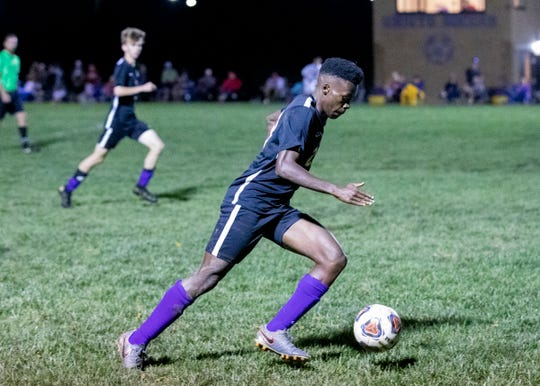 Unioto's Vijay Wangui dribbles the ball in a 4-0 win over Zane Trace at Unioto High School on Sept. 23, 2019, in Chillicothe, Ohio.