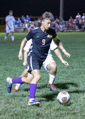 Unioto's Ethan Kerns dribbles the ball down field during a 4-0 win over Zane Trace at Unioto High School on Sept. 23, 2019, in Chillicothe, Ohio.