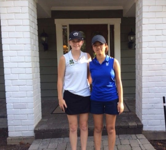 Sydney Mallaley (left) of McNicholas and Victory Lee of Wyoming pose after a one-on-one round of golf on Sept. 11.