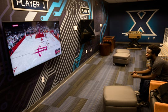 Jasel Boateng, a Xavier junior from Toronto, plays NBA 2K19 in the E-Sports Lounge at Xavier University on Tuesday, Sept. 24, 2019.