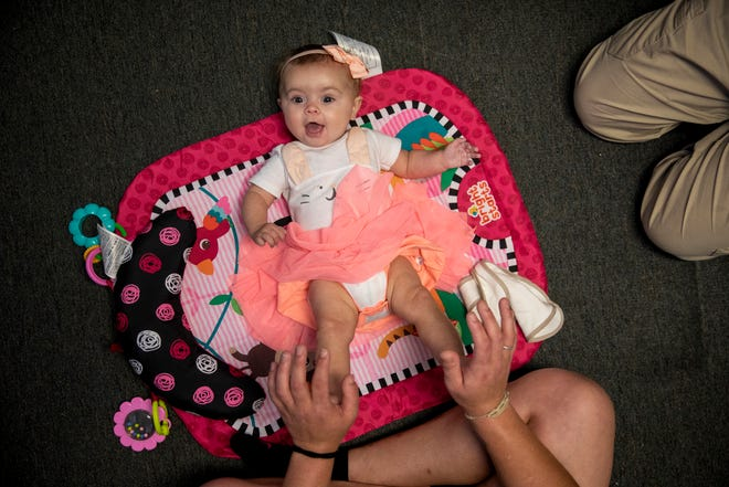 Brittany Hill plays with her 4-month-old daughter, Rosie, during a therapy session at First Step Home in Walnut Hills.