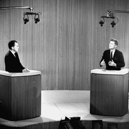 In this Oct. 21, 1960 file photo, Sen. John F. Kennedy, D-Mass., right, speaks and Vice President Richard M. Nixon listens during the fourth presidential debate from a New York studio.