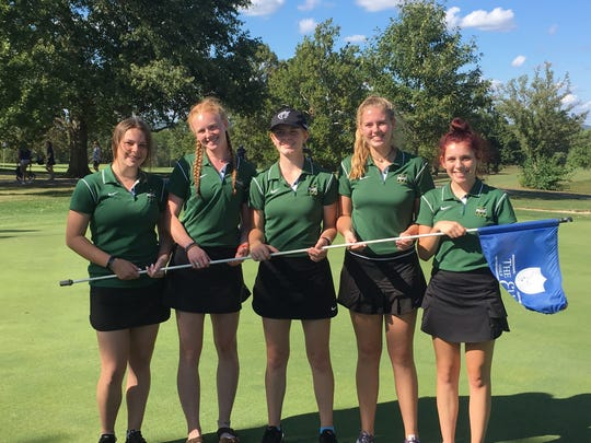 McNicholas golfers including Sydney Mallaley (center) and Lydia Geygan (second from right) pose at the Hamilton Elks Golf Course after the Girls Division II Golf Sectional on Sept. 23.