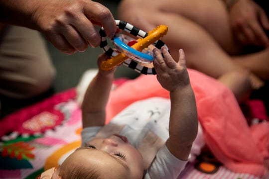 Rosie, 4 months, plays with her speech pathologist Jill Huff during a recent therapy session. Rosie had trouble feeding consistently as a newborn. She is enrolled in a First Step Home Child Resiliency program for children who face trauma or therapy needs that may stem from their mothers' substance-use disorders.