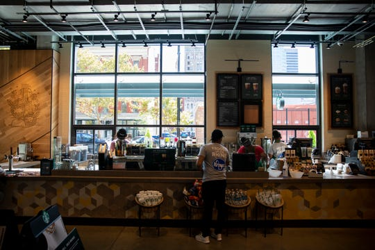 Kroger employees prepare the Starbucks at the Kroger on the Rhine store Tuesday, Sept. 24, 2019 on the corner of Walnut and Court Streets. This Starbucks will feature a unique walk-up window that will serve customers outside on Court Street.