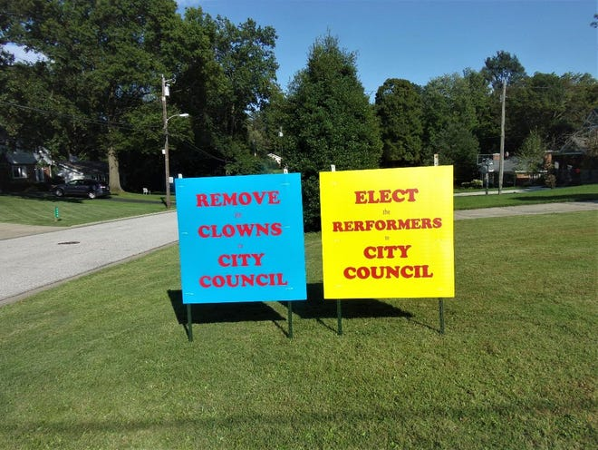 Madeira resident Doug Oppenheimer prompted a review of the city's political yard-sign regulations when he put these signs in his yard.