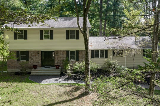 Nestled ina setting of 3.76 open and wooded acres, a Colonial in Lebanon Township with up-to-the-minute details is for sale for $469,900.