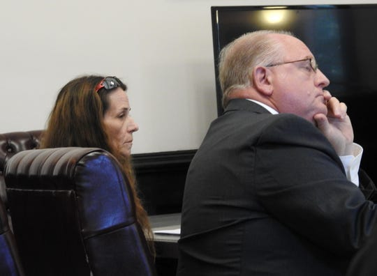 Angela Crook and her attorney Jeffrey Mullen in Coshocton County Common Pleas Court Tuesday. Crook was on trial for charges relating to drug trafficking.