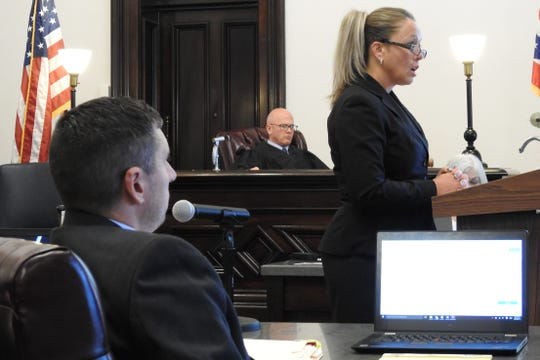 Assistant Proseuctor Ben Hall and Judge Bob Batcchelor observe Assistant Prosecutor Christie Thornsley address a jury Tuesday in the trial of Angela Crook on charges relating to drug trafficking.