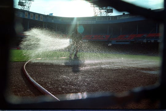 Eric Wheeler waters the field before the Tigers faced the Royals in the final game at Tiger Stadium on Sept. 27, 1999.