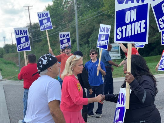 U.S. Rep. Debbie Dingell talks to people walking the picket line at Romulus Powertrain Plant on Monday, September 16.