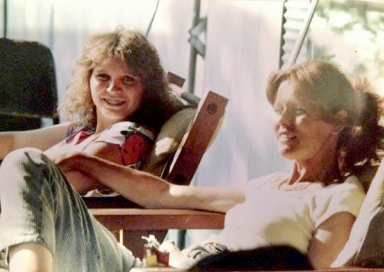 In this 1987 photo, Debbie Pickworth, left, sits outdoors beside her mother, Sharon Sutter. Both women went on to develop lung cancer. Sharon Sutter died in 1997 at the age of 49. Debbie Pickworth was diagnosed with Stage IV lung cancer in 2013 when she was 43.