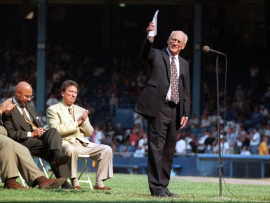 Detroit Mayor Dennis Archer and Tigers owner Mike Ilitch listen as Ernie Harwell addresses the crowd before the Tigers beat the Kansas City Royals, 8-2, in the final game at Tiger Stadium on Sept. 27, 1999.