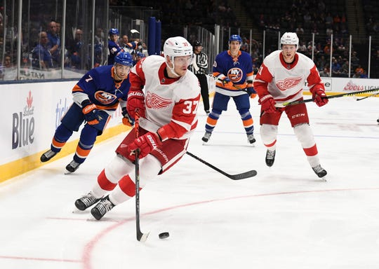 Red Wings forward Evgeny Svechnikov skates with the puck ahead of the Islanders' Jordan Eberle and Red Wings defenseman Dennis Cholowski during the second period of the Wings' 3-2 overtime loss to the Islanders in the preseason game on Monday, Sept. 23, 2019, in Uniondale, N.Y.