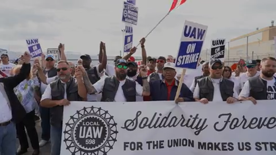 UAW boosts strike pay to $275 per week as talks with GM continue