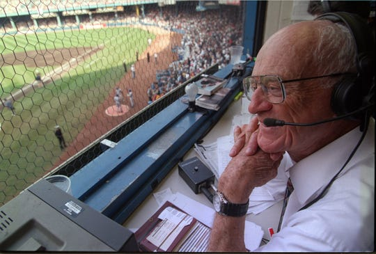 Ernie Harwell in the booth during the Tigers beat the Kansas City Royals, 8-2, in the final game at Tiger Stadium on Sept. 27, 1999.