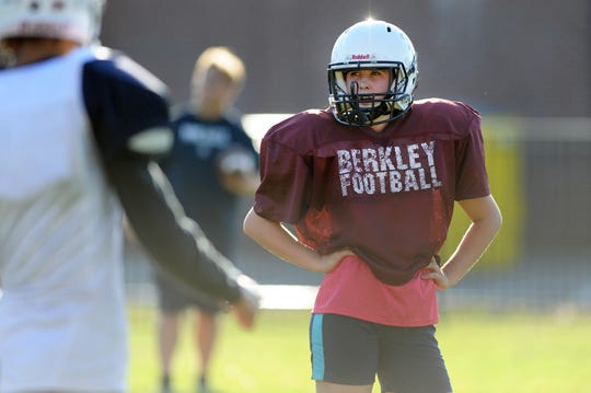 Berkley High School football safety Marcella DePaul waits for instructions from head coach Sean Shields during practice.