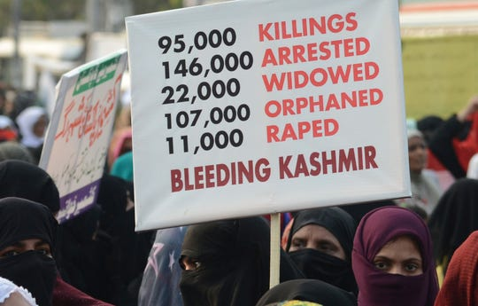 Pakistani rally to express solidarity with Indian Kashmiris in Lahore, Pakistan, Friday, Sept. 13, 2019. Pakistan's prime minister Imran Khan assured residents of disputed Kashmir on Friday that he will expose years-long Indian oppression and human rights violations in the region when he addresses the U.N. General Assembly this month.