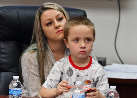 6-year-old burn victim Caleb Tahmouch and his mom 25 year old Sarah Tahmouch during a press conference announcing a lawsuit filed against three companies for injuries suffered from steam spewing from Detroit manhole covers. September 24, 2019. Southfield, Michigan.