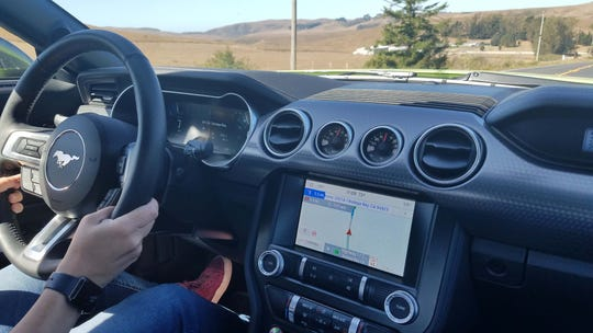 The interior of the 2020 Ford Mustang HiPo is nicely appointed with digital display, buttons, and toggle switches for controls. The aviator vents are signature 'Stang.