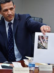 Attorney Robert Lantzy displays a photo of burn victim 5 year old Caleb Tahmouch leg after he was burned crossing a manhold near the Science Center during a news conference announcing a lawsuit filed against three companies for injuries suffered from steam spewing from Detroit manhole covers. September 24, 2019. Southfield, Michigan.