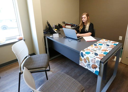 Riley Benz works at her desk as the new shelter manager at the Fond du Lac Humane Society Tuesday, September 24, 2019 at 652 Triangle Road in Fond du Lac, Wis. Doug Raflik/USA TODAY NETWORK-Wisconsin